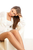 Woman resting. Portrait of young woman resting, on white background royalty free stock photos