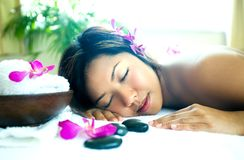 Woman resting as she enjoys a body therapy Royalty Free Stock Image