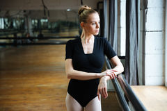 Woman resting in ballet class Stock Image
