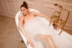 Woman resting in bathtub Stock Photography