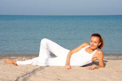 Woman resting on the beach Stock Photo