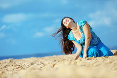 Woman resting at the beach Royalty Free Stock Photography