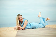 Woman resting at the beach Stock Image