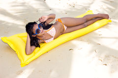 Woman resting on the beach Stock Photography