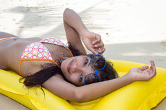 Woman resting on the beach Royalty Free Stock Photography