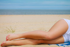 Woman resting on beach. Stock Image