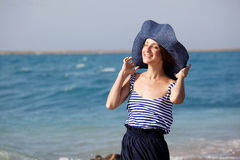 Woman resting on the beach in summer day Royalty Free Stock Photography
