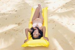 Woman resting on the beach Stock Photos