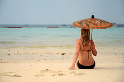 Woman resting on the beach Royalty Free Stock Image