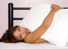 Woman resting in bed Stock Image