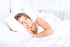 Woman resting in bed. Bedtime collection: woman resting in bed Royalty Free Stock Photography