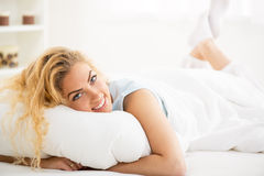 Woman resting in the bed Royalty Free Stock Image