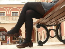 Woman resting on the bench. Young woman resting on the bench on the square Royalty Free Stock Photos