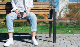 Woman resting on the bench. Stock Photo