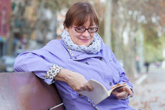 Woman  resting on   bench in   park. Stock Photography