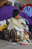 Woman resting in Bolivian Independence Day parade in Brazil Stock Photo