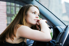 Woman resting in a car Stock Photography