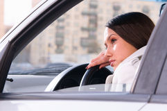 Woman is resting in a car Royalty Free Stock Photo