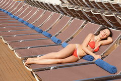 Woman is resting on chaise  lounge Royalty Free Stock Photo
