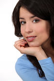 Woman resting chin on hand Royalty Free Stock Photos