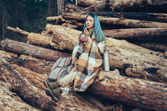 Woman resting with cup of tea Stock Image
