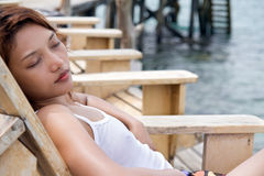 Woman resting on deck chair Stock Image