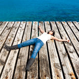 Woman Resting in a Dock Stock Images