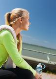 Woman resting after doing sports outdoors Royalty Free Stock Photos