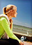 Woman resting after doing sports outdoors Royalty Free Stock Image