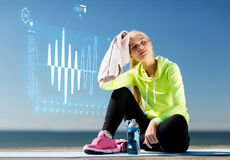 Woman resting after doing sports outdoors Royalty Free Stock Images