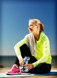 Woman resting after doing sports outdoors Royalty Free Stock Photography