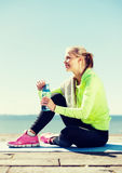 Woman resting after doing sports outdoors Stock Photography