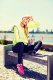 Woman resting after doing sports outdoors Stock Image