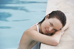 Woman Resting On The Edge Of Swimming Pool Royalty Free Stock Image