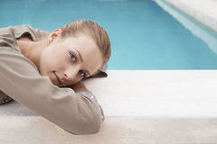 Woman Resting On Edge Of Swimming Pool Royalty Free Stock Photos