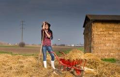 Woman resting on the farmland Stock Photos