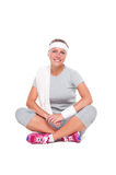 Woman resting after fitness. Smiley young woman resting after fitness. isolated on white background Royalty Free Stock Photo