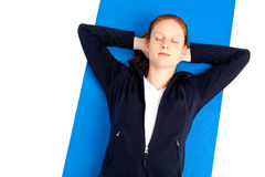 Woman resting on fitness mat Royalty Free Stock Photos