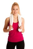 Woman resting after fitness workout with towel arounfd her neck. Isolated over white Stock Images