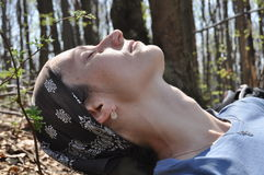 Woman resting in the forest. Hiking in the mountains Royalty Free Stock Photo