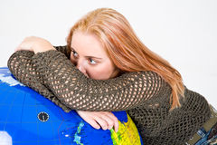 Woman Resting on Globe Stock Image