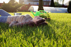 Woman resting on green grass Royalty Free Stock Images