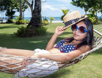 Woman is resting in the hammock Royalty Free Stock Images