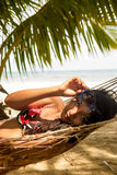 Woman is resting in the hammock Stock Photos