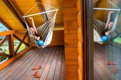 Woman resting in hammock Stock Photo