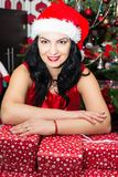 Woman resting hands on Xmas gifts Royalty Free Stock Photo