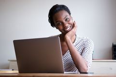Free Woman Resting Head On Hand Sitting At Desk With Laptop Royalty Free Stock Image - 118889526