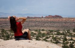Woman resting on a hike. Sitting down to rest while hiking in Moab Royalty Free Stock Photos