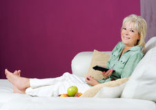 Woman resting at home Stock Photography