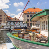 Woman resting on a houseboat in Copenhagen. Girl reading a book on houseboat Christianshavn Copenhagen Denmark Stock Images